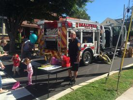 Battalion Chief Jerry Vaughn providing fire prevention and education information at Malvern Fall Fest